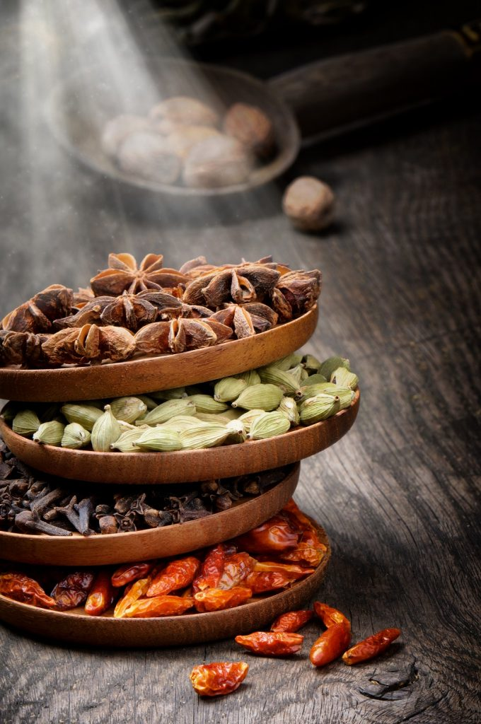 Colorful mix of spices on old wooden table